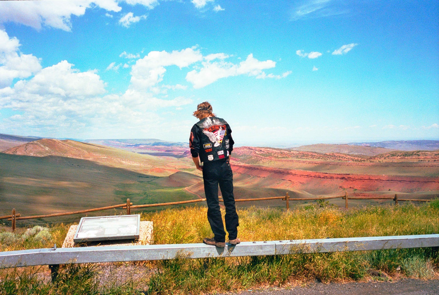 A Man Stands On A Guardrail, Red Canyon Wyoming