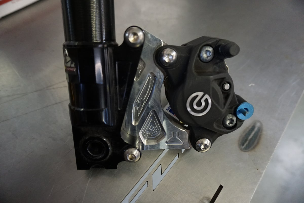Brembo P32 caliper adapter