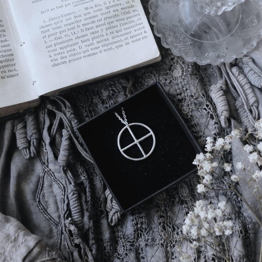 Image of MINI CHIISIKAAW. PETROGLYPH TALISMAN ↟ sustainable sterling silver - medicine wheel / solar cross