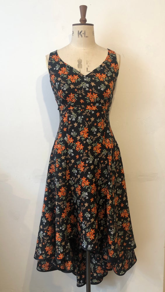 Image of Navy and orange floral waterfall dress