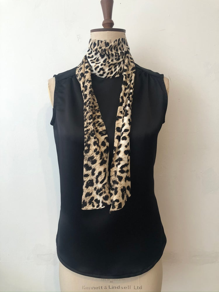 Image of Leopard and black lulu top