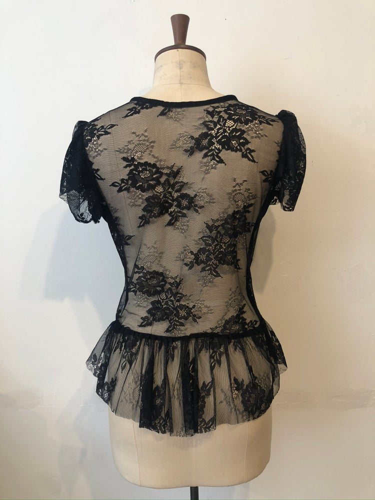 Image of Lace back ruffle top