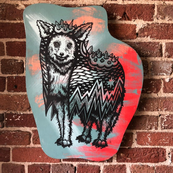Image of Coyote in a Crystal Cloak on Raised Pine