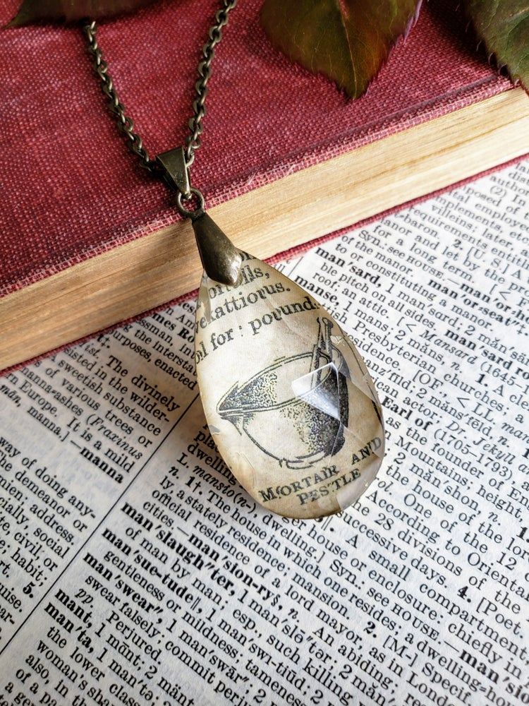 Image of Mortar & Pestle Vintage Science Book Pendant Necklace