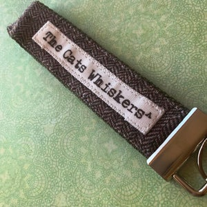 Image of The Cats Whiskers key fob