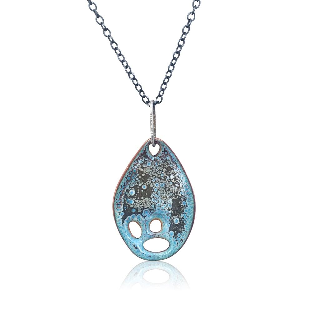 Image of vita pendant -- overfired