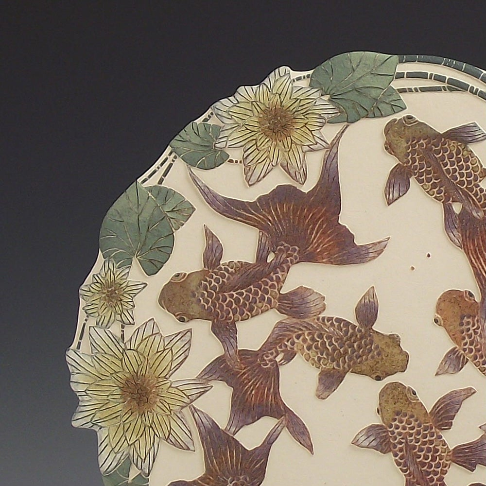 Fantailed fish ceramic sgraffito wall art