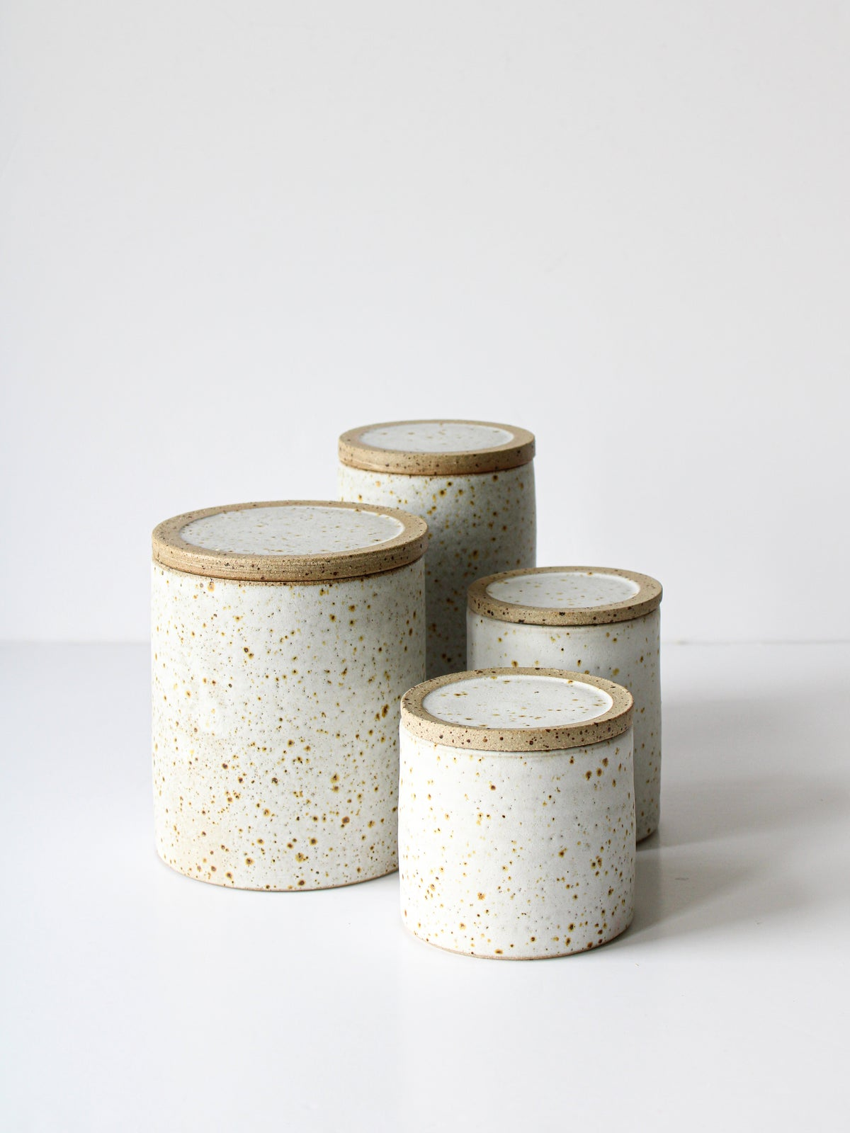 Image of raw rim lidded jars - different sizes