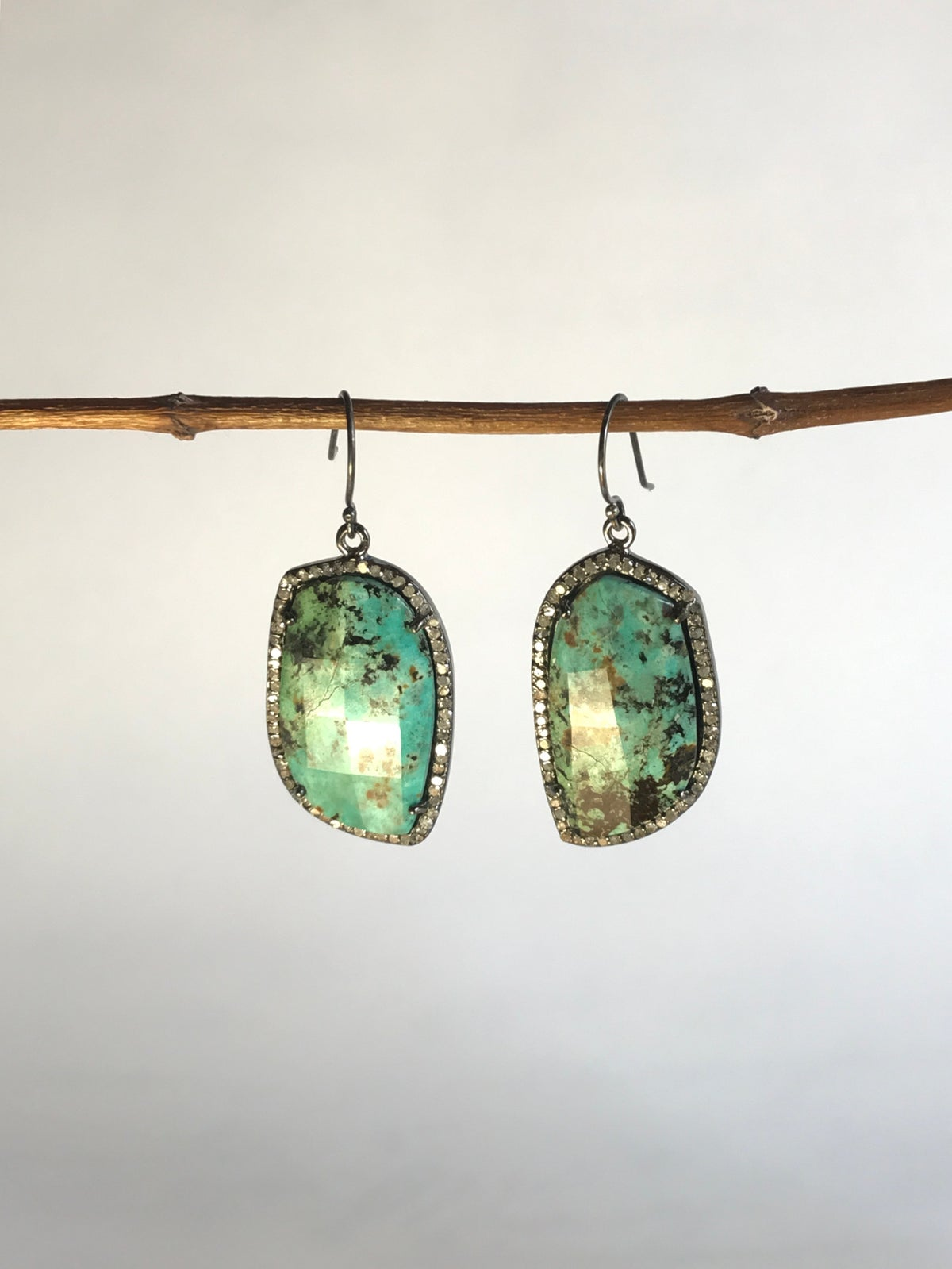 Faceted Turquoise Surrounded by Diamond