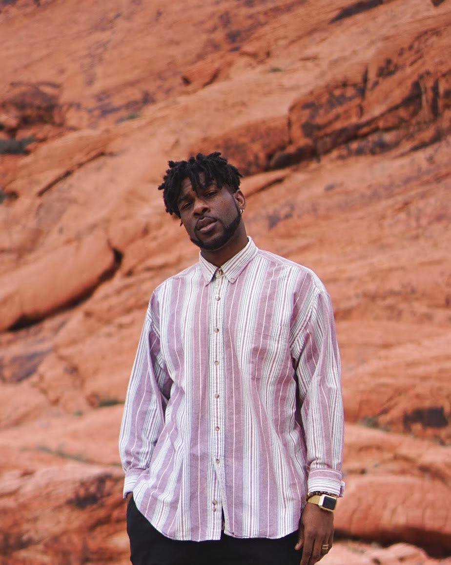 Image of pink stripped button up.