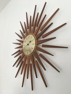 Sun burst clock