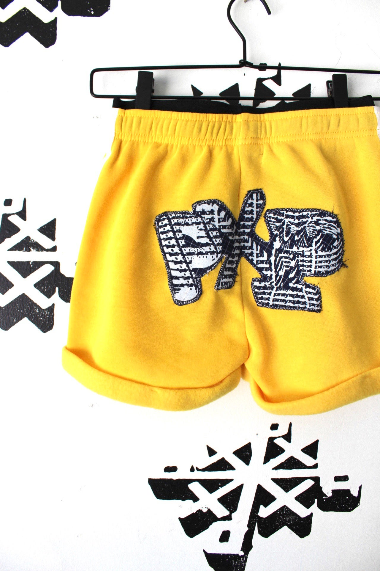Image of top notch shorts in yellow