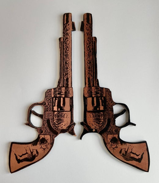 Image of Oversized Toy Revolvers  by Charlie Evaristo-Boyce