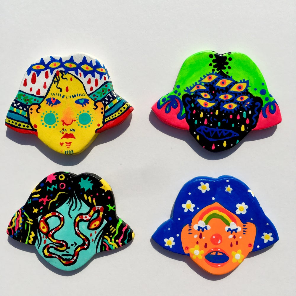 Image of Head brooches