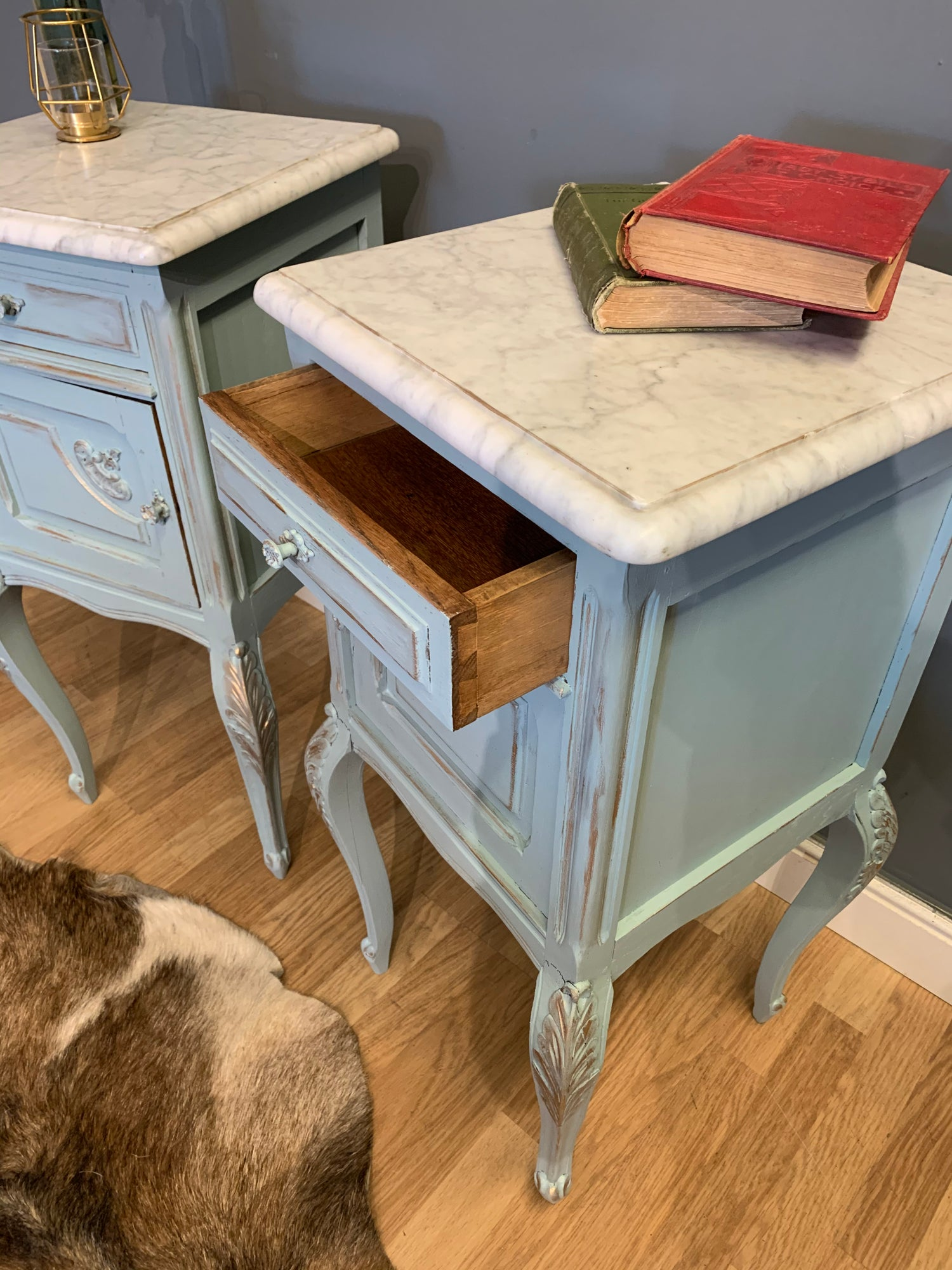 Image of Marble top vintage French bedside tables