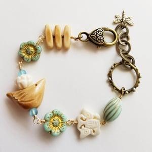 Image of Springtime Birds, Butterflies, Flowers Bracelet (Tan + Pale Blue)