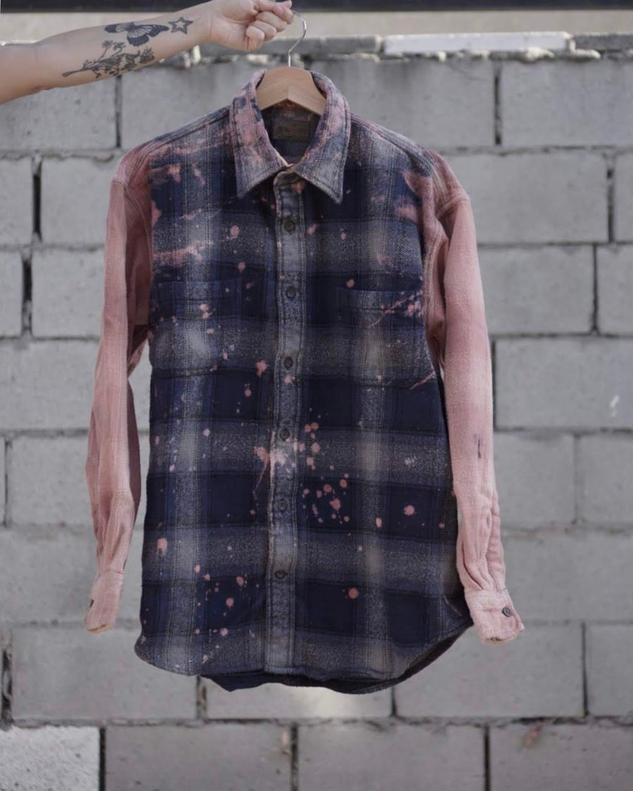 Image of pink sleeved galaxy flannel.