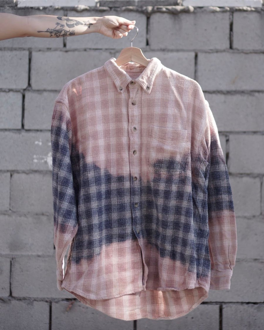 Image of dusty pink w/ navy in the middle flannel.