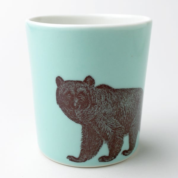 Image of 16oz tumbler in aqua, with bear
