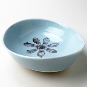 Image of deep beachstone serving bowl, ocean with cosmos