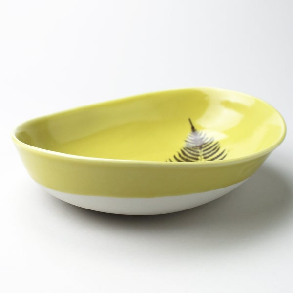 Image of deep beachstone serving bowl, mustard with lady fern