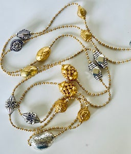 Image of detailed charm collection.