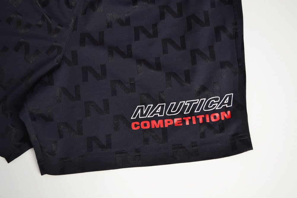 Image of Vintage 1990's Nautica Competition All Over Print Shorts Sz.XL (Youth)