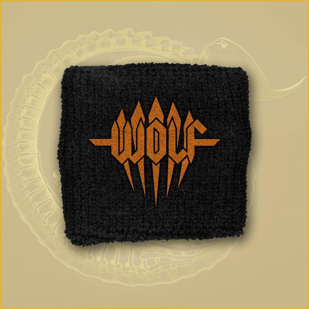 Image of Wristband - Orange embroidered logo.