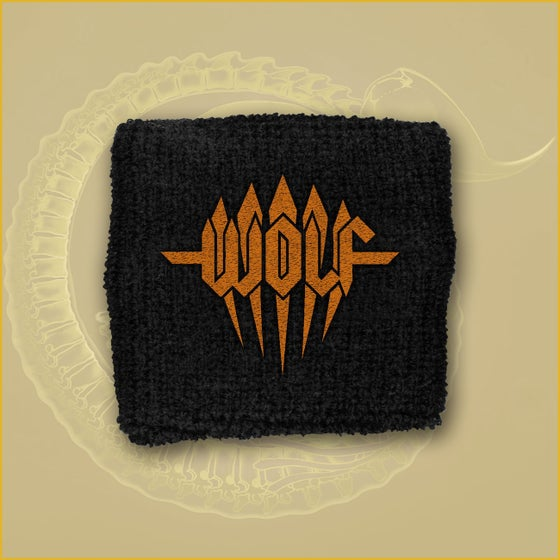 Image of Wristband - Orange embroidered logo.