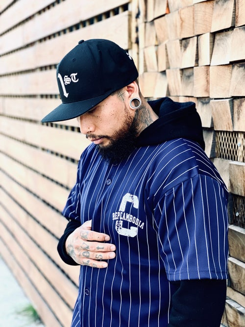 Image of NAVY BLUE PIN STRIPED VINTAGE ARCH BASEBALL JERSEY