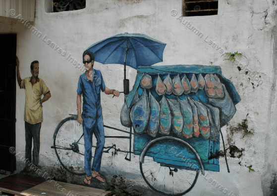 Image of T9 Man with cart street art Malaysia