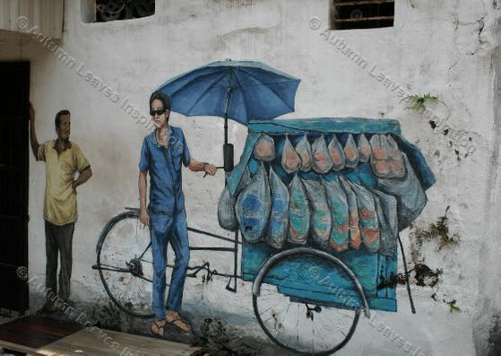 Image of T9 Man with cart street art Malaysia