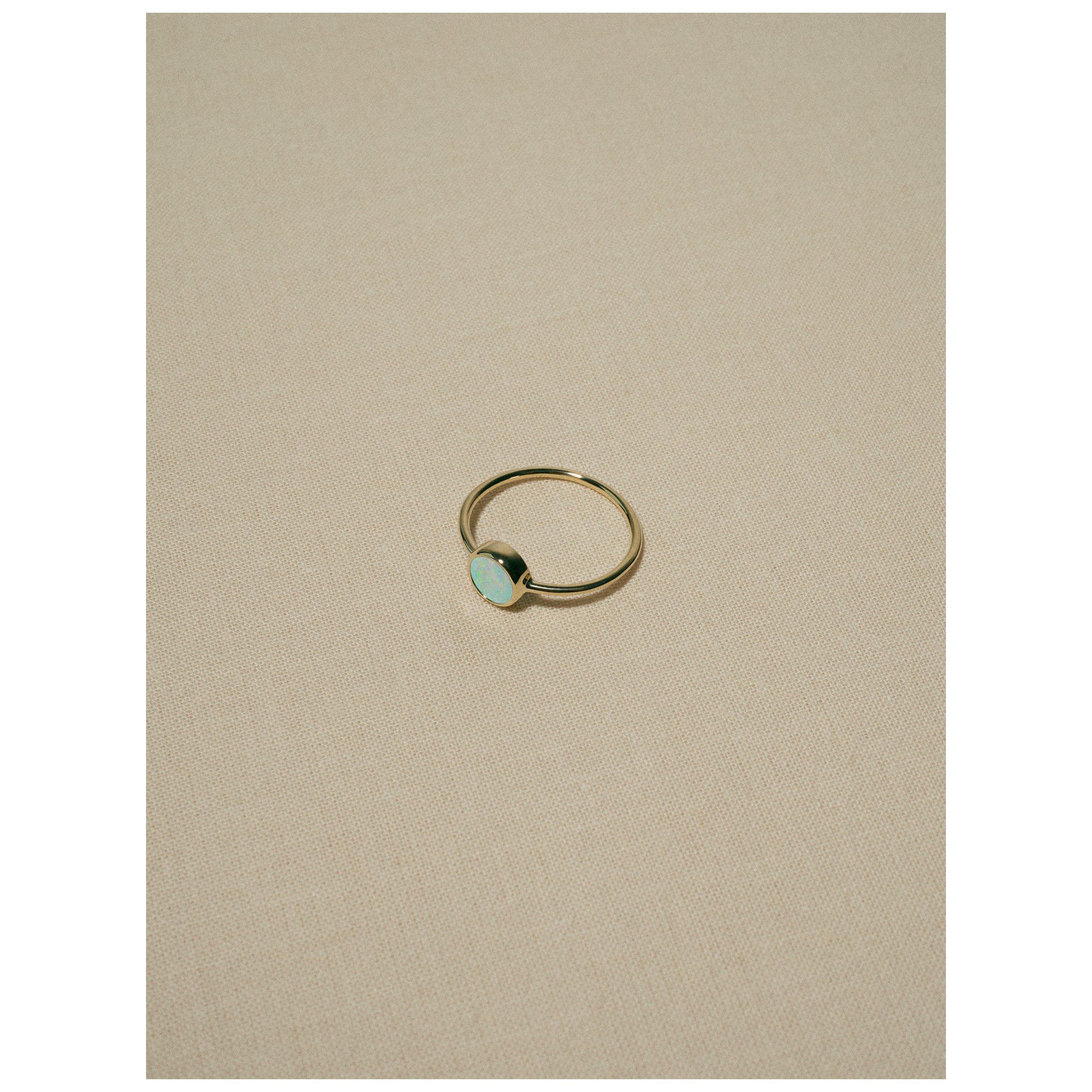 Image of gem opal ring · gold