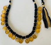 Image of coin necklace with black cord