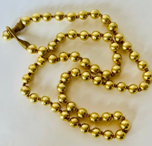 Image of round gold beaded neck