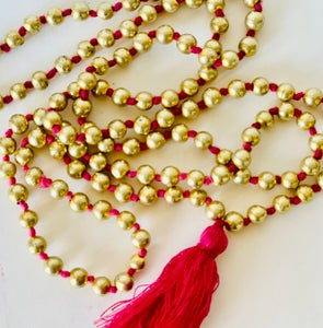 Image of tiny bead pom-pom necklaces. 3 colors