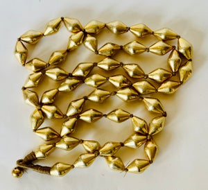 "Image of 38"" long strand of oval shaped beads"