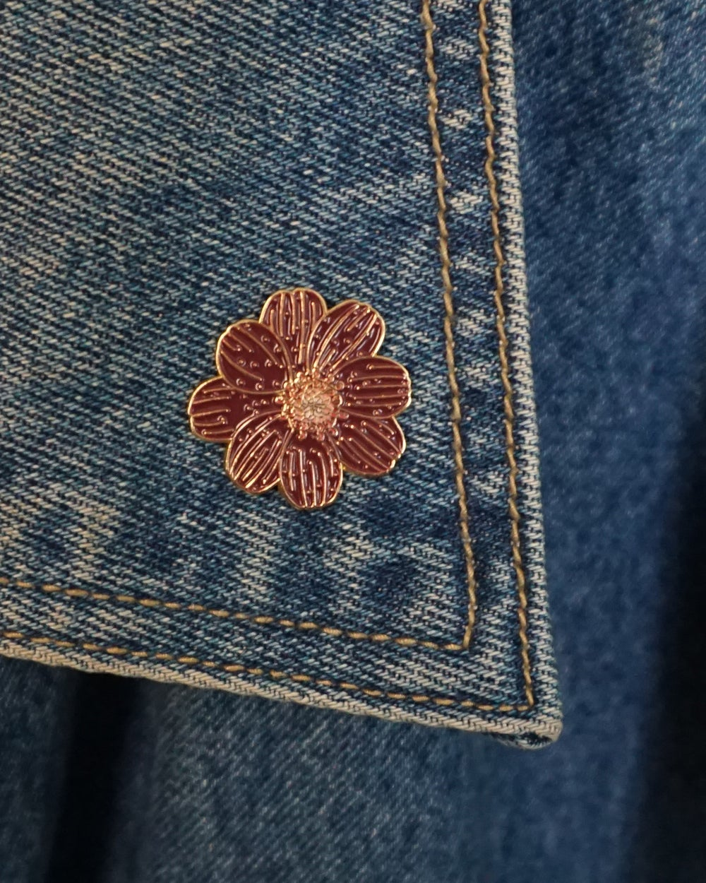 Image of chocolate cosmos flower pin.