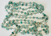 "Image of 54"" rough pale emerald beads"