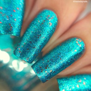 Image of I'm Polish Remover B@#!h – A light teal metallic foil flake with micro red metallic glitter