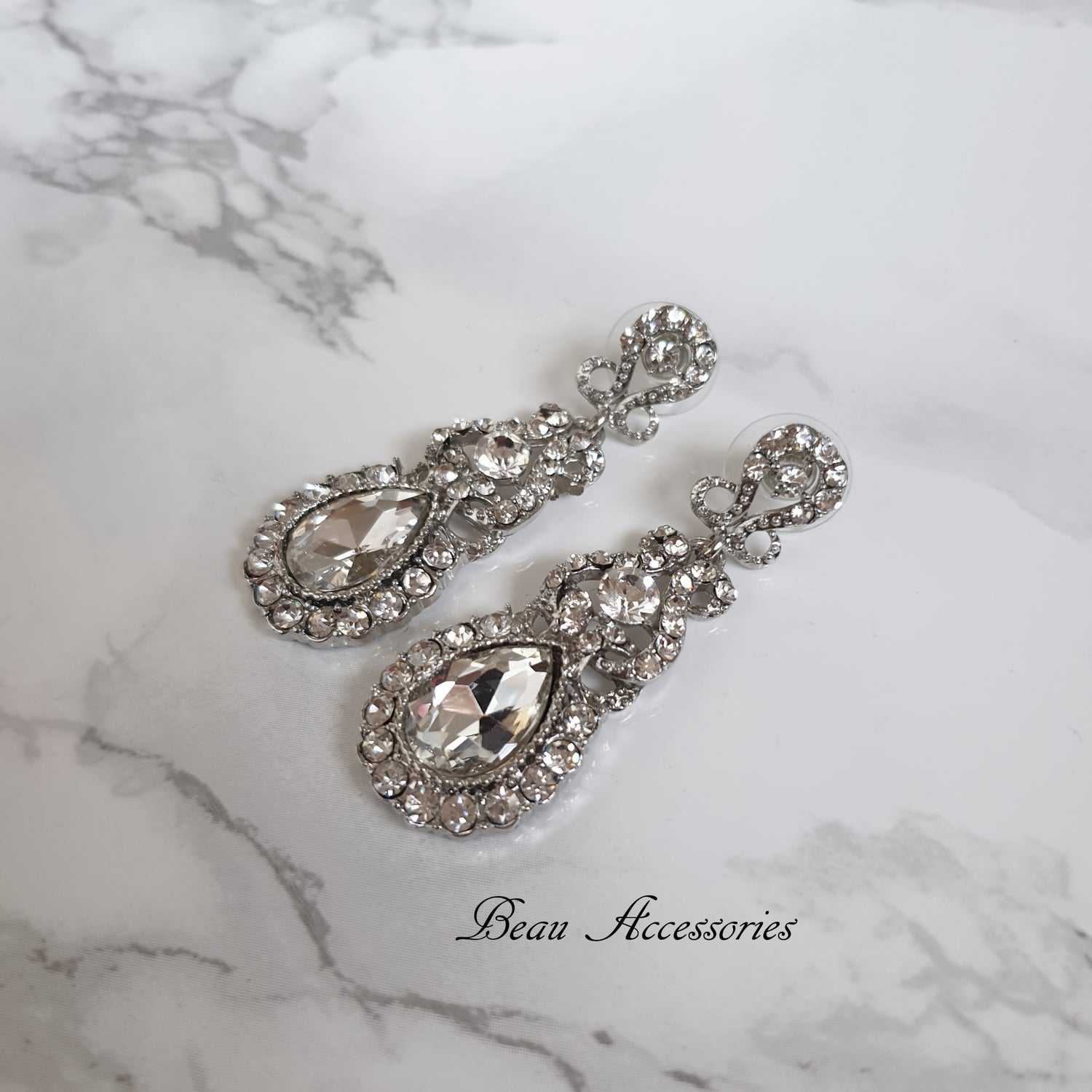 Image of Silver Oval Crystal Drop Earrings