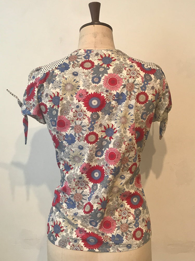 Image of Spotty and floral handkerchief blouse