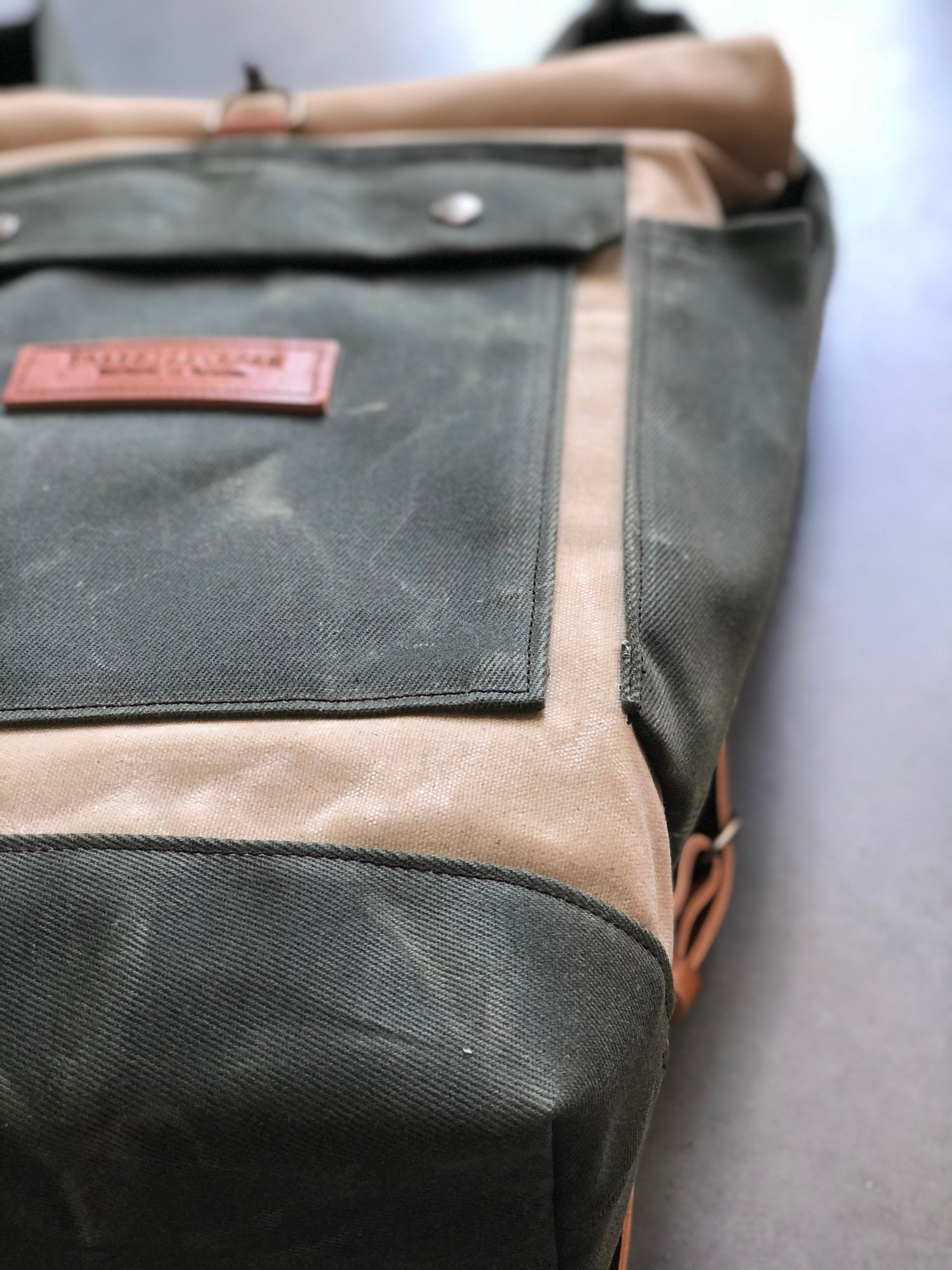 Image of Natural and olive green waterproof waxed canvas backpack medium size with padded shoulder straps