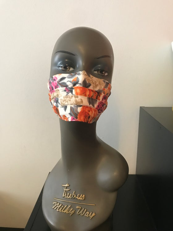 Image of Orange floral face mask