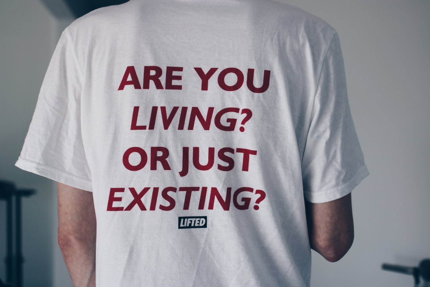 Image of Living or Existing Tee