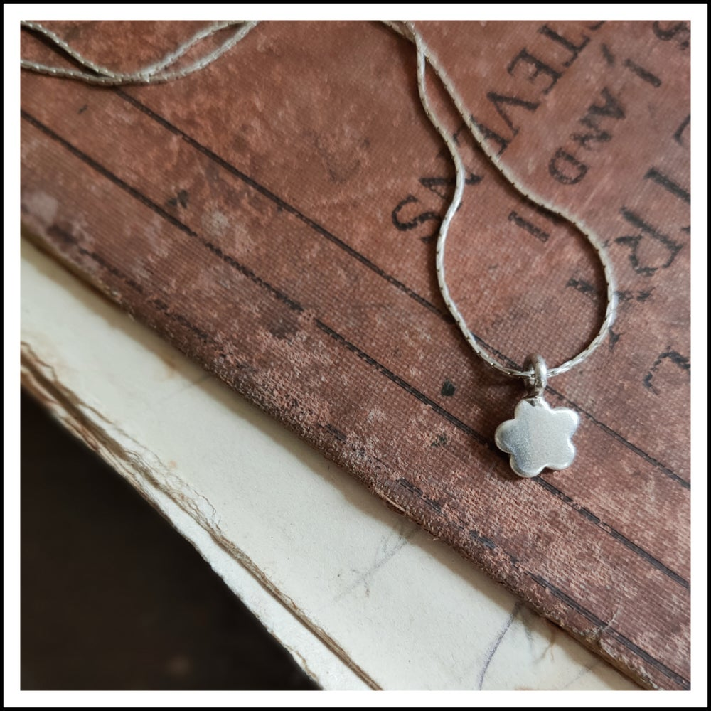 Image of Sterling silver floral silhouette pendant necklace