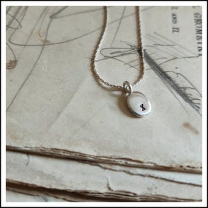 "Image of Sterling silver oval pendant necklace stamped ""x"""