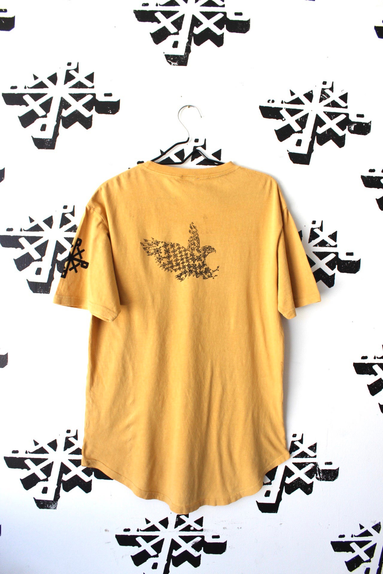 Image of fly in fly out tee in gold
