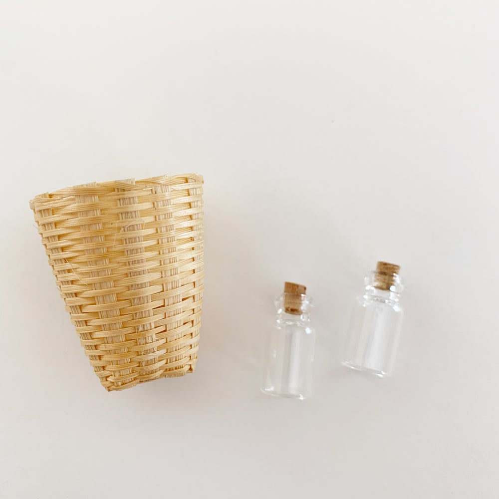 Image of Dollhouse Laundry Hamper and Glass Bottles