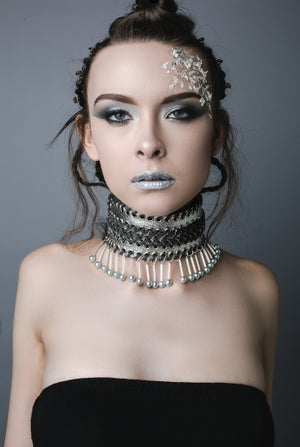 Image of wide silver collar with pearl droplets